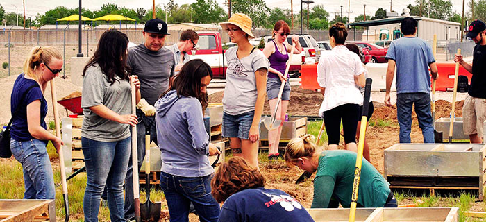 Image of students building a community garden.